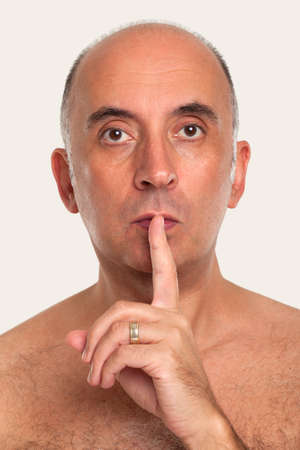 noiseless: Man saying silence, quiet