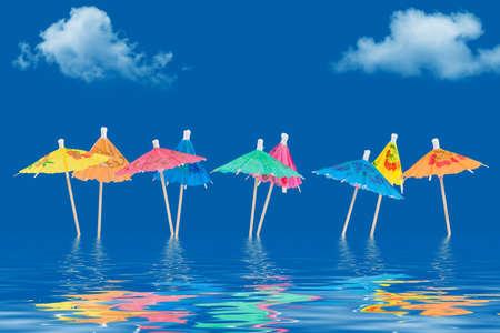 Paper umbrellas standing in water Imagens