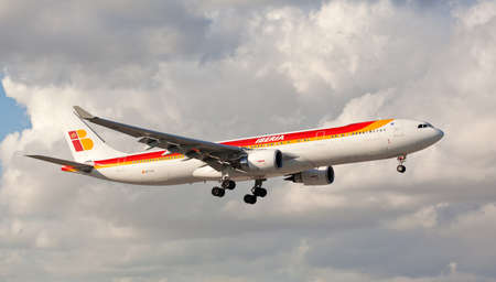 MIAMI, USA - March 24, 2015: An Iberia Airbus 330-300 landing at Miami International Airport. Iberia is the flag carrier and the largest airline of Spain.