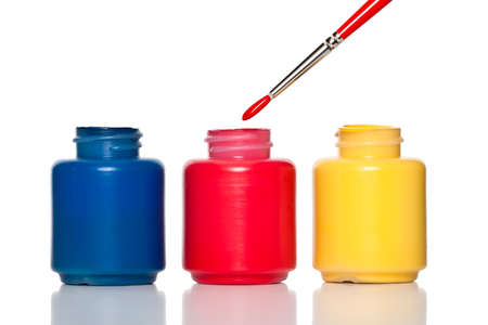 vibrant paintbrush: Colorful paint containers and a brush