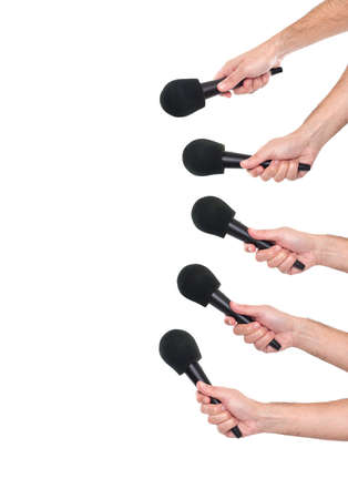 several: Several hands holding microphones