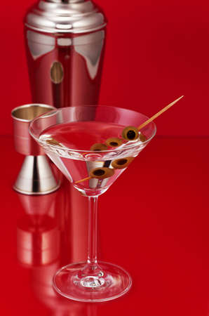 martini shaker: Dry Martini with shaker and measure glass in the background Stock Photo