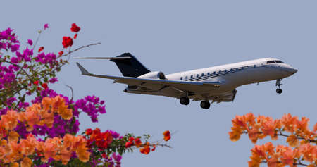 Side view of a private jet flying Editoriali