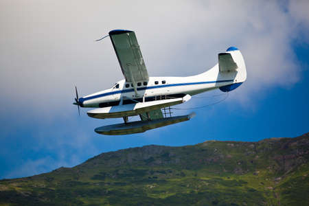 Single engined seaplane coming in to land in Alaska