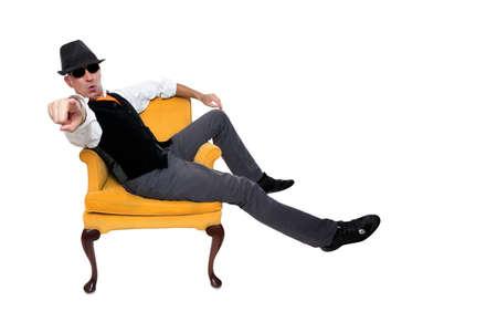 ファッショナブルな男が椅子に座って 写真素材