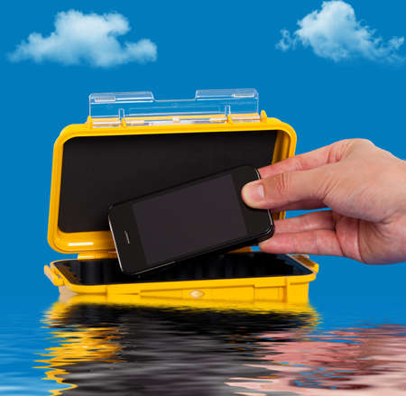 safe water: Storing a cell phone in a water resistant case Stock Photo