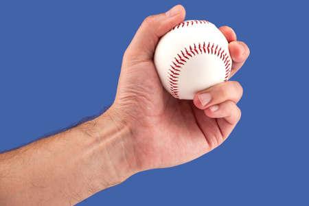 hardball: Player with a baseball in hand