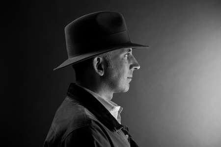 clues: Man in a hat looking at the light