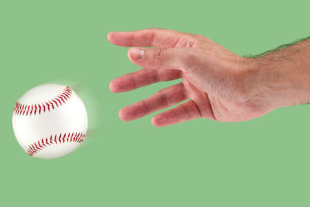 throwing: A hand throwing a baseball