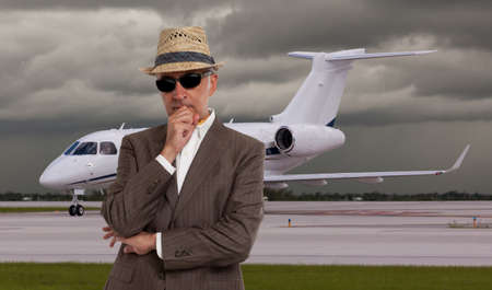 private airplane: Business man thinking in front of private airplane Stock Photo