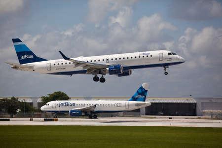 aircraft landing: FORT LAUDERDALE, USA - May 24, 2015: A Jetblue Airlines Embraer 190 aircraft landing at the Ft. LauderdaleHollywood International Airport, Florida.