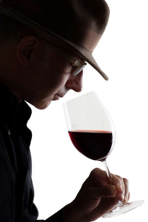 olfaction: Man smelling a glass of red wine