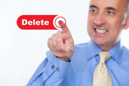 definitive: Man pushing the delete button Stock Photo