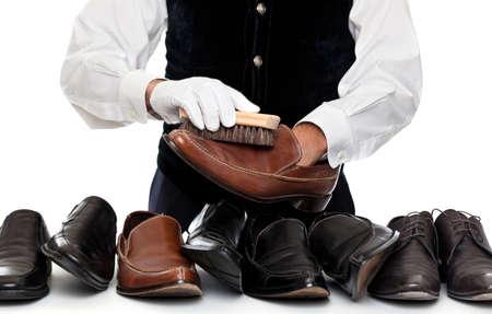 革靴を磨く男 写真素材