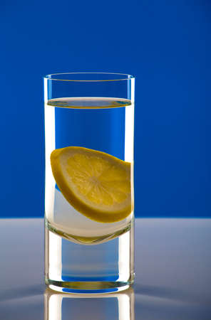 tall glass: Tall glass of water with a lemon slice