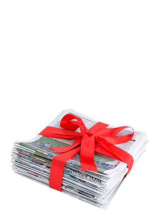 newspaper stack: Newspaper stack with red bow Stock Photo