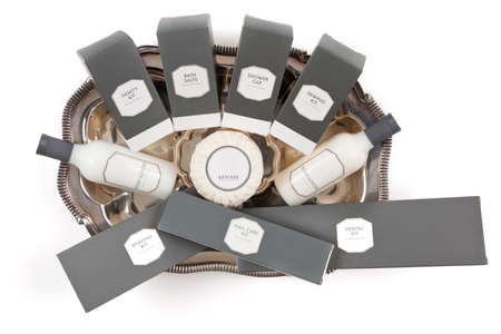 Hotel amenities kit on silver platter Stockfoto