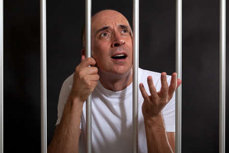 Man asking for mercy in prison Stock Photo