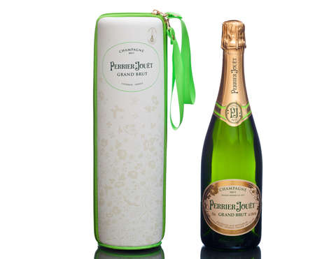 champagne region: MIAMI, USA - March 24, 2015: Champagne bottle with enchanting nature case. Perrier-Jouet is based in the Epernay region of Champagne. Founded in 1811, the house produces 3,000,000 bottles annually.