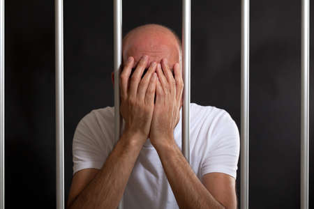 clemency: Man distressed in jail Stock Photo