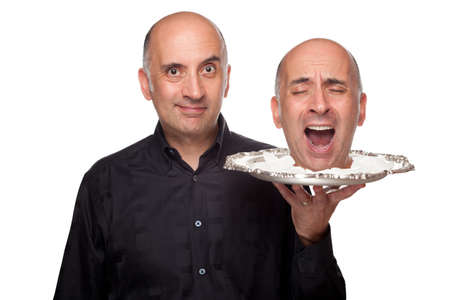 Man holding a head on a platter