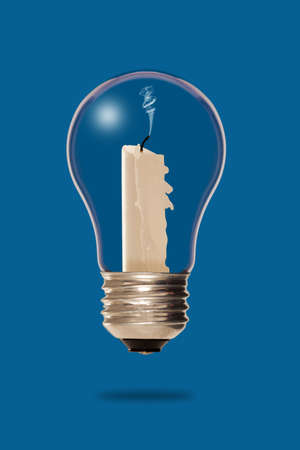 Extinguished candle inside a light bulb