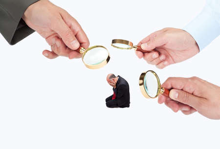 humiliated: Hands with magnifier glasses looking, studying or selecting a person