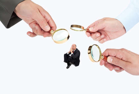 tiny lenses: Hands with magnifier glasses looking, studying or selecting a person