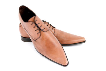 Brown pointy shoes with shallow depth of field