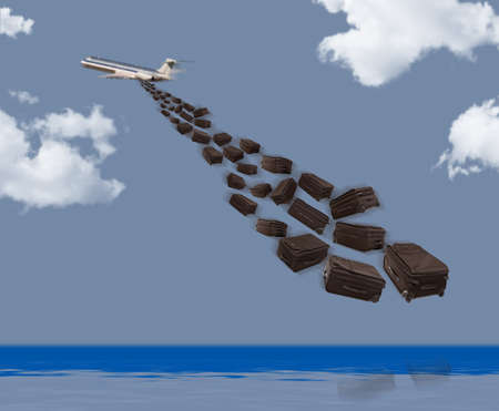 Bags falling from a passenger airplane Stock Photo