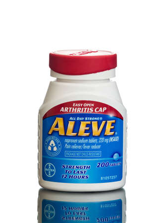 reducing: MIAMI, USA - February 9, 2015: Bottle of ALEVE 220mg naproxen sodium pain and fever reducing tablets. Editorial