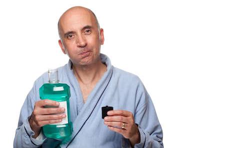Man rinsing with mouthwash