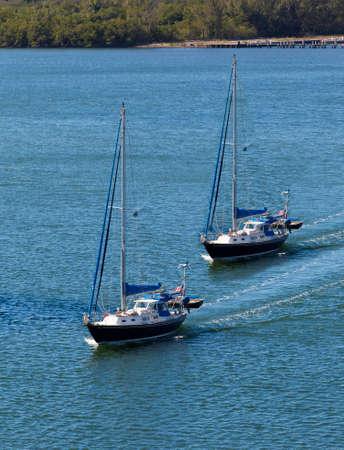 Two sail boats navigating