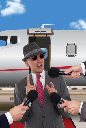 corporate jet: Businessman standing in front of corporate jet  Image ID: 136807616