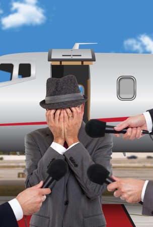 corporate jet: Businessman standing in front of corporate jet crying