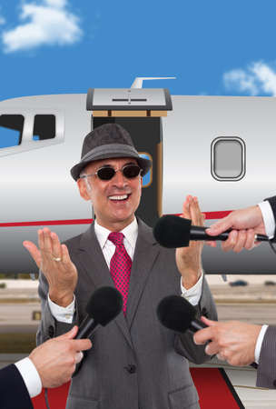 corporate jet: Businessman being interviewed in front of corporate jet