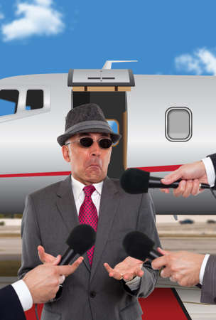 interviewed: Businessman being interviewed in front of corporate jet
