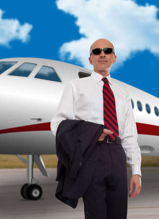 private plane: Businessman standing in front of a private plane