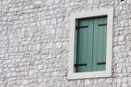 Window on the stoned wall
