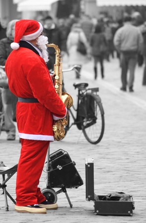 marginalization: Santa Claus with saxophone