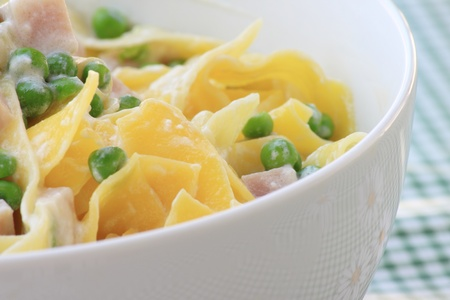 Italian pasta with pease, ricotta and baked ham photo