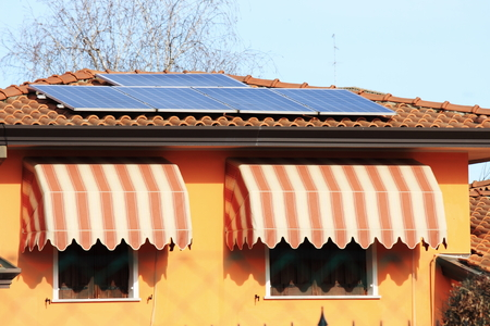 Solar panels on the roof of a house Standard-Bild - 107749123