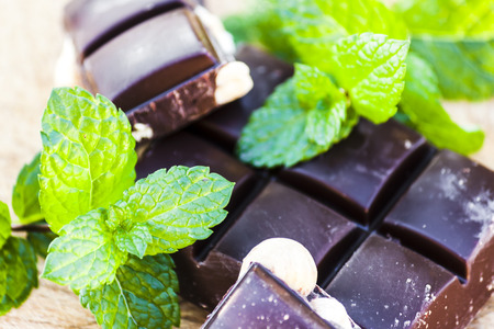 Chocolate with nuts and fresh mint