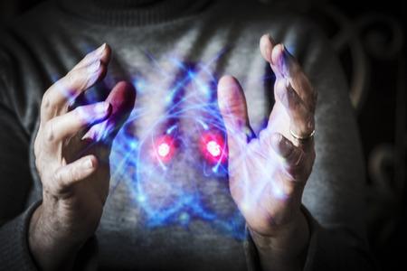 womans hands: Womans hands controlling atoms Stock Photo