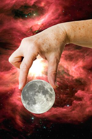 picking hand: Hand picking the moon