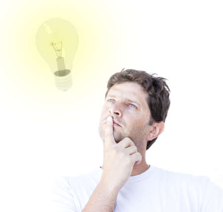 Young man is thinking to an idea: a shining bulb is in front of him while thinking