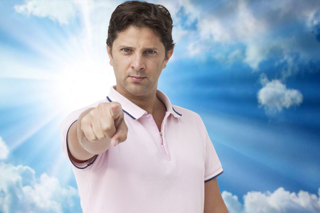 trusting: Young man pointing finger to you Stock Photo