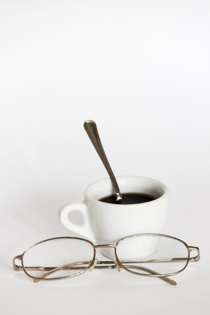 Cup of coffee and eye glasses