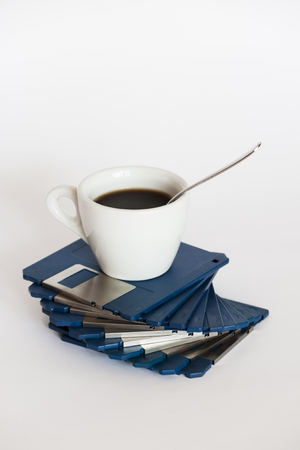 Coffee cup on floppy disks