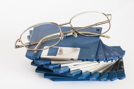 Eye glasses on floppy disks Stock Photo